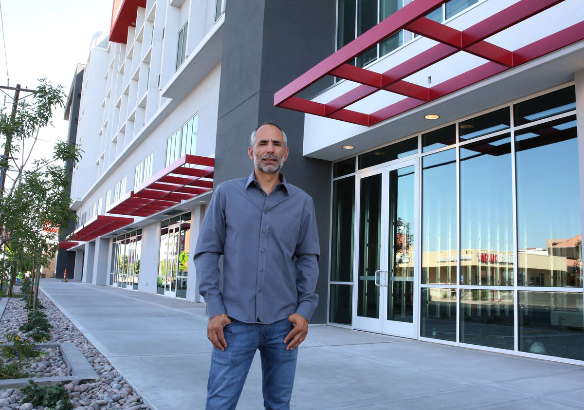 Frank Marretti III, founder of G2 Capital Development, poses for a photo in font of a new apart ...