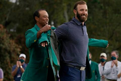 Tiger Woods, left and Dustin Johnson during the final round of the Masters golf tournament Mond ...