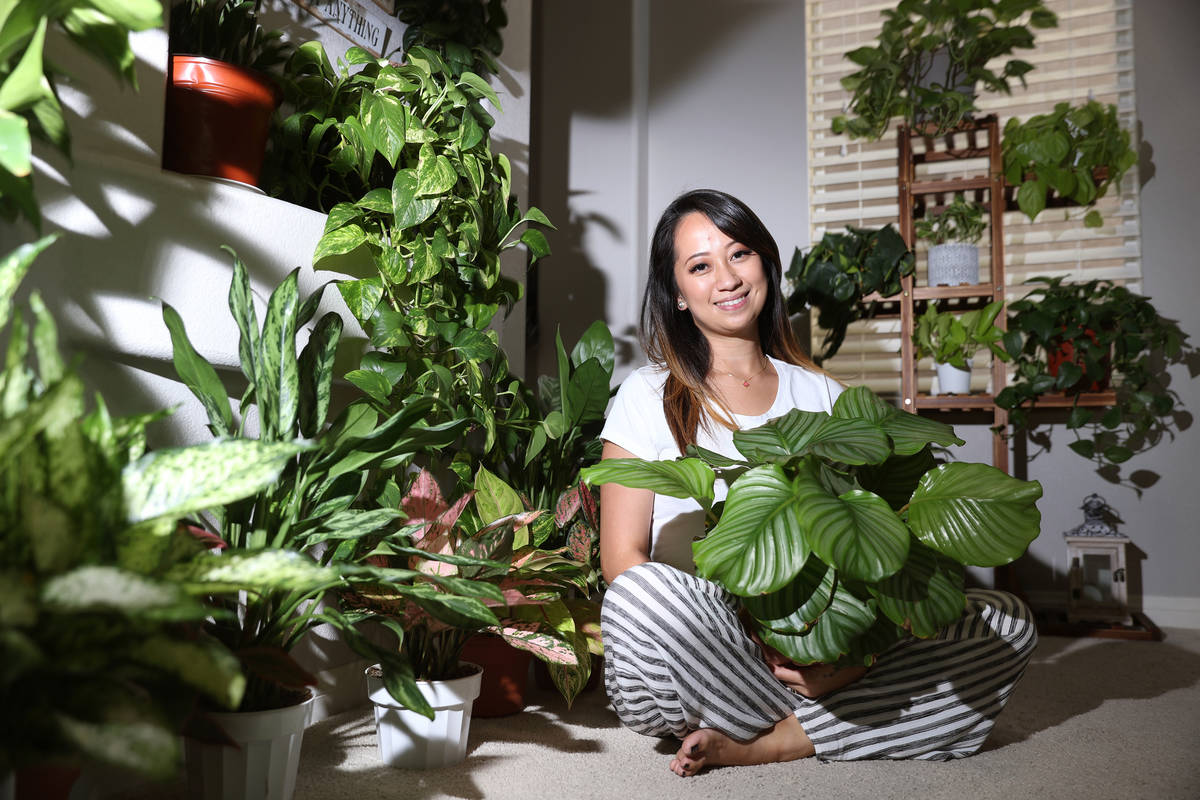 Plant enthusiast Clariselle Felias poses for a portrait at her home in Las Vegas on Thursday, N ...