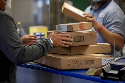 Packages are dropped off to ship at the Spring Valley United States Postal Service, in Las Vega ...