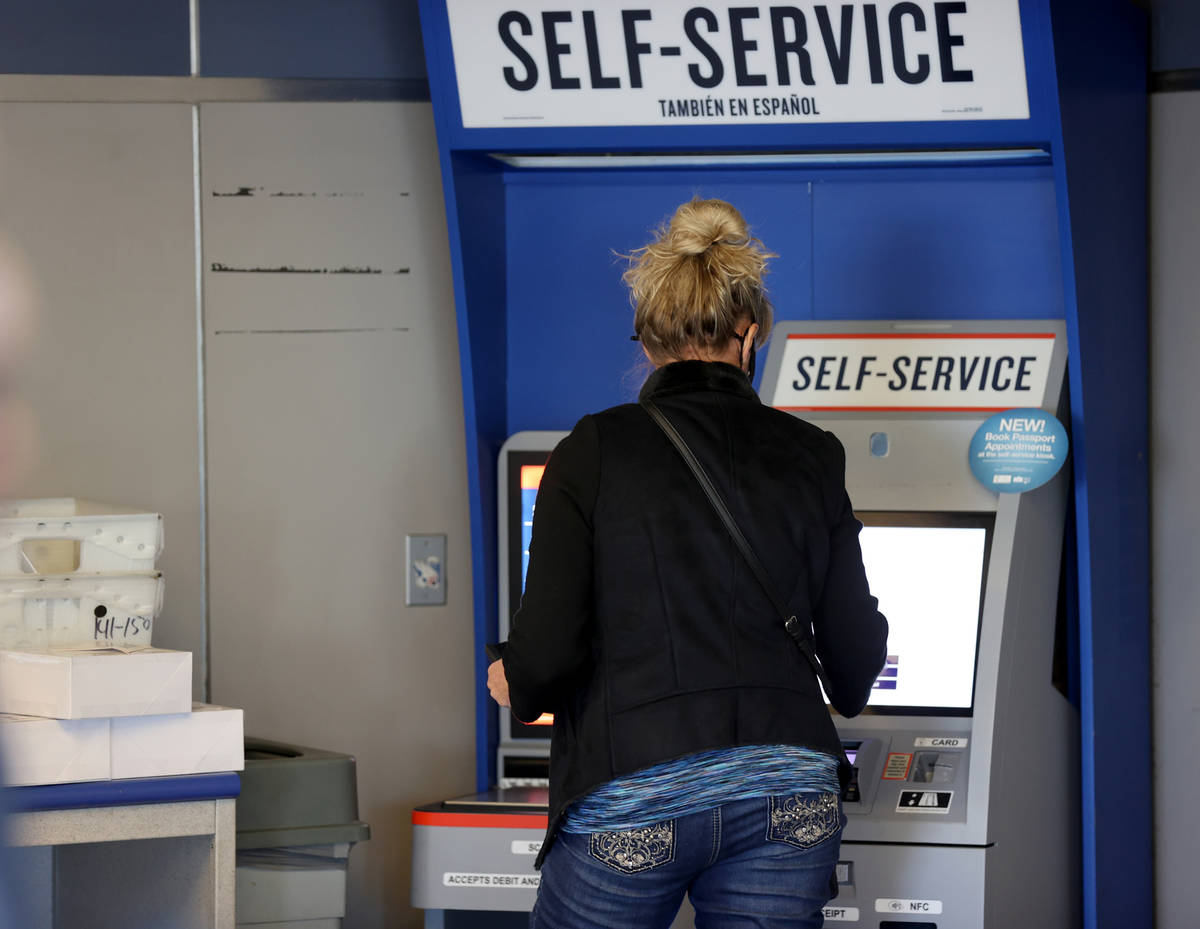 A customer uses a self-serve kiosk at the main Las Vegas Post Office on Sunset Road Wednesday, ...