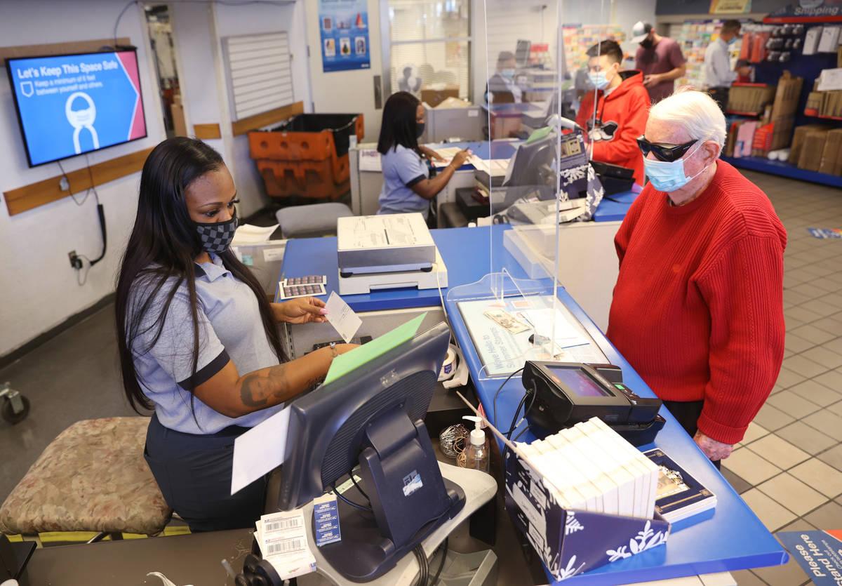 Prenciss Rogers helps Ken Callahan of Las Vegas at the main Las Vegas Post Office on Sunset Roa ...