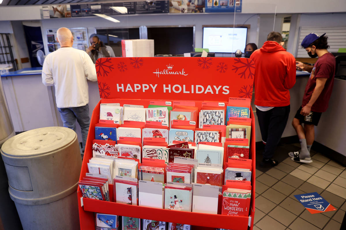 Customers ship packages at the main Las Vegas Post Office on Sunset Road Wednesday, Nov. 25, 20 ...