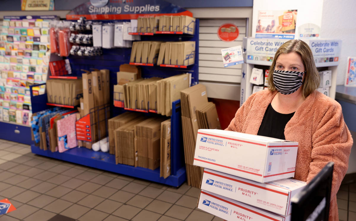 Kim Leddon of Phoenix ships packages at the main Las Vegas Post Office on Sunset Road Wednesday ...