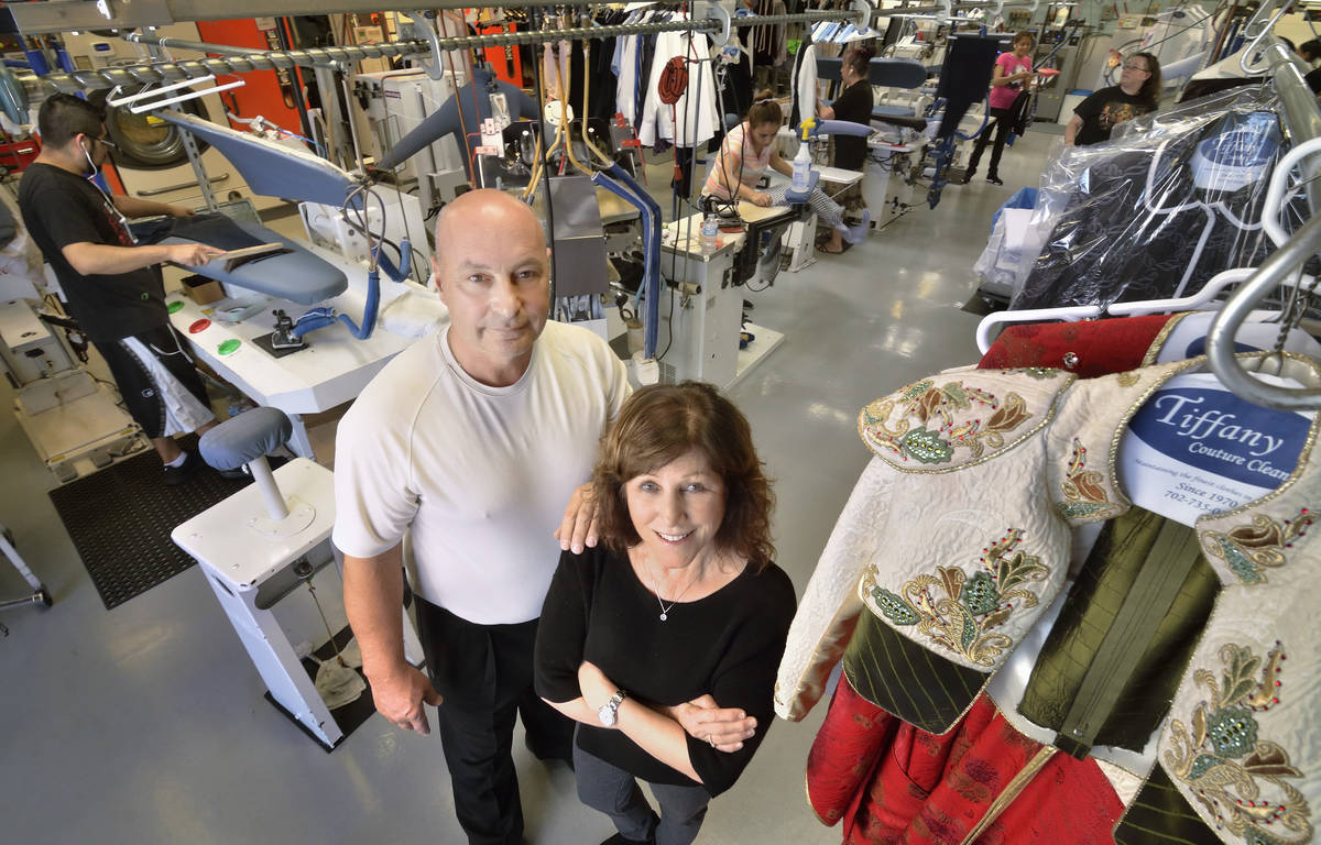 Dan and Judy Del Rossi, owners of Tiffany Couture Cleaners, are shown in the cleaning and press ...