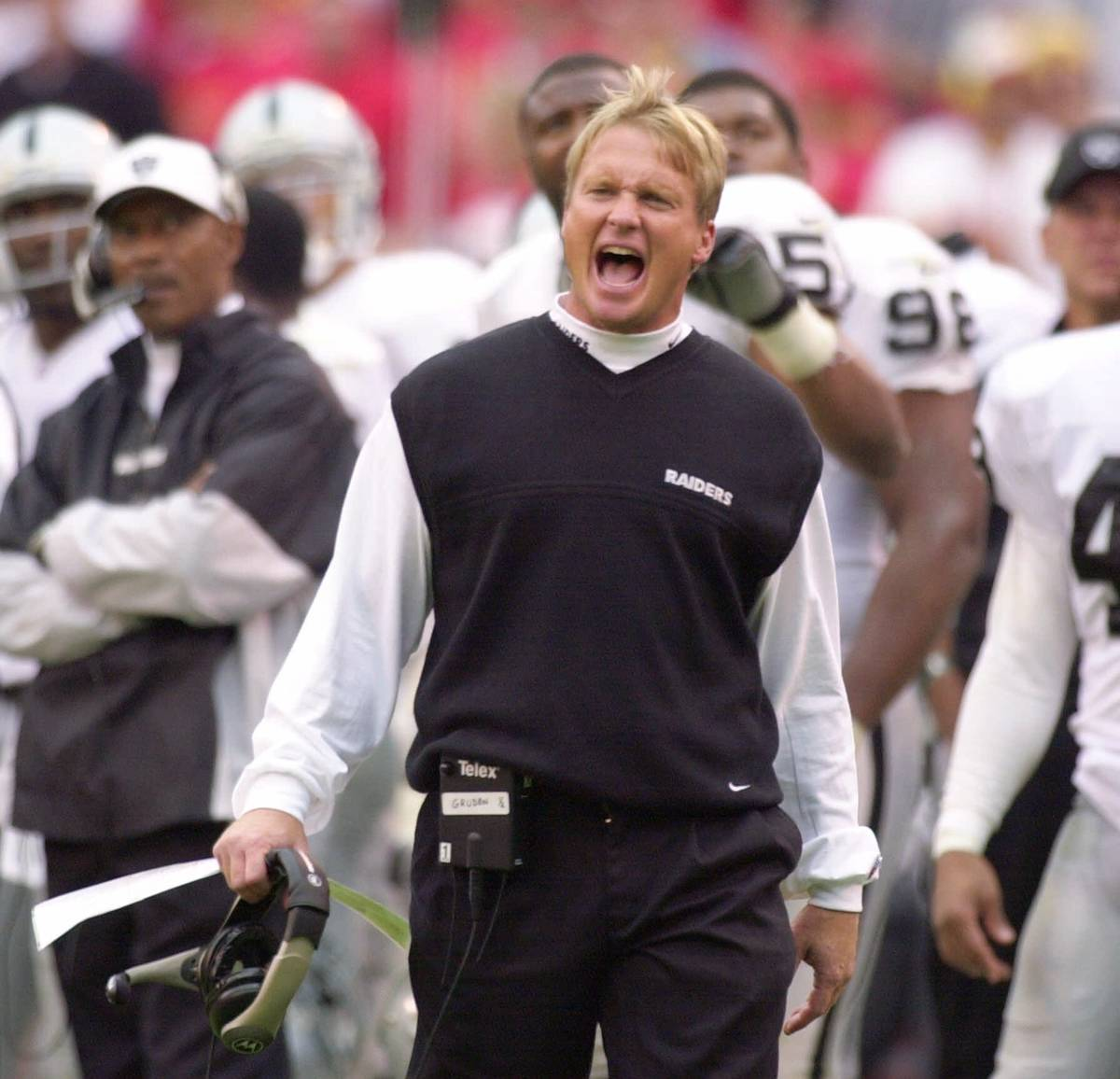 Oakland Raiders coach Jon Gruden yells to his team while officials review a play in the second ...