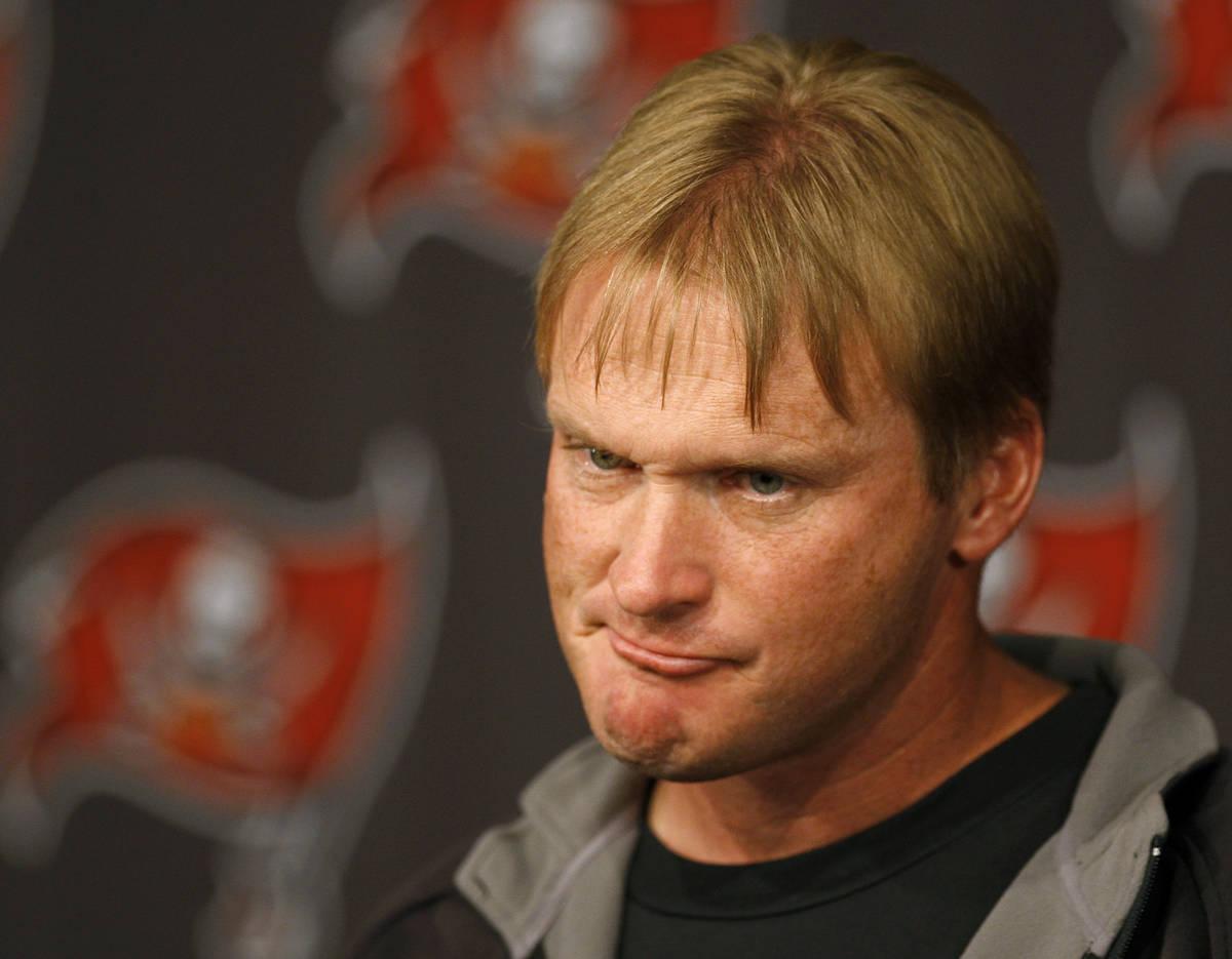 Tampa Bay Buccaneers head coach Jon Gruden grimaces as he speaks to the media during his weekly ...