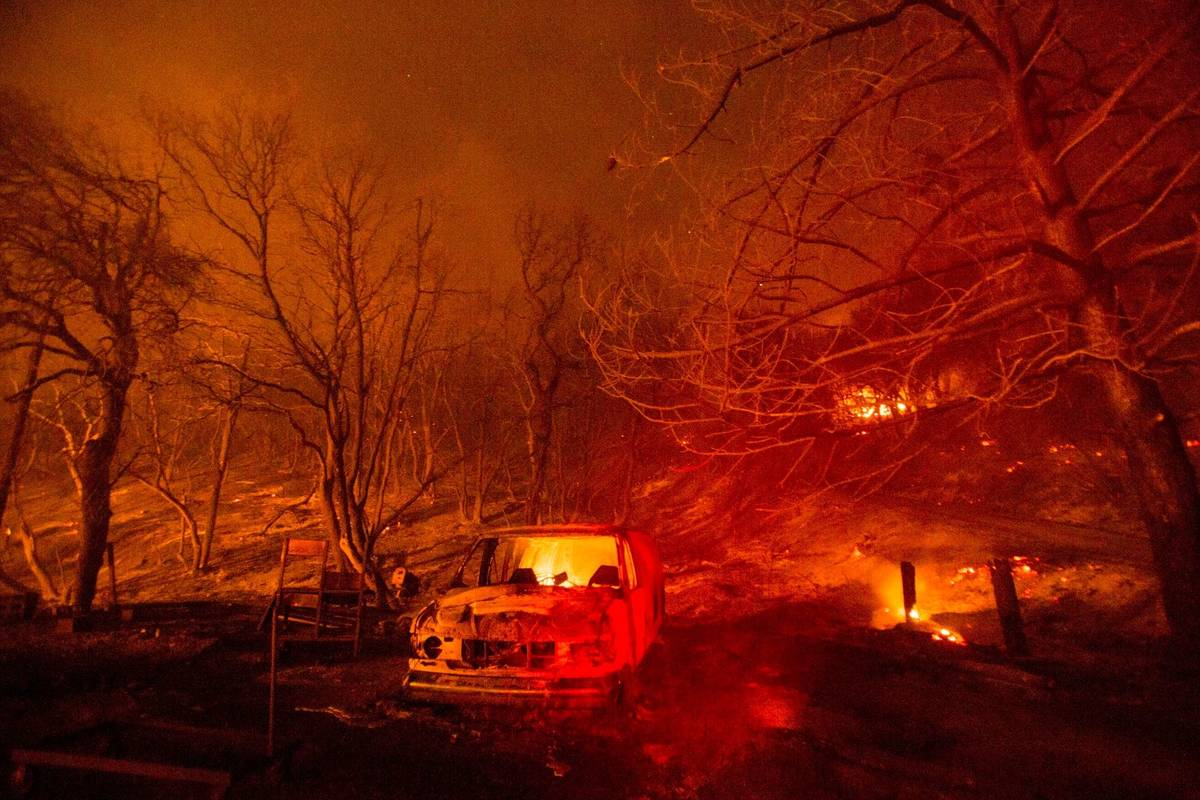 A burned vehicle is seen in the Lake Hughes Fire in Angeles National Forest on Thursday, Aug. 1 ...