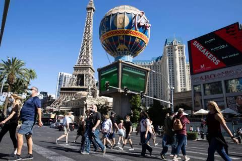 Tourist walk past Paris Las Vegas on Friday, Oct. 23, 2020, in Las Vegas. (Bizuayehu Tesfaye/La ...