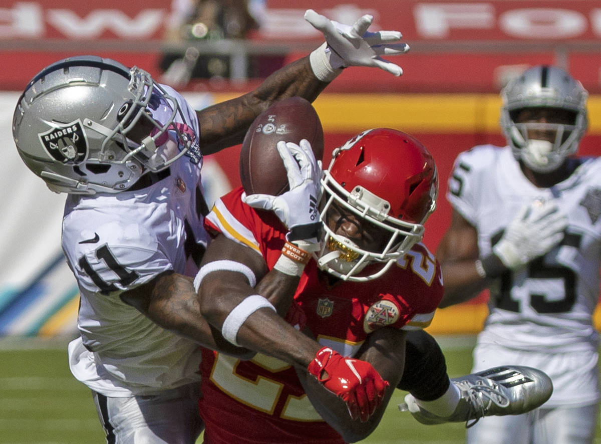 Las Vegas Raiders wide receiver Henry Ruggs III (11) pulls in an acrobatic catch over Kansas Ci ...