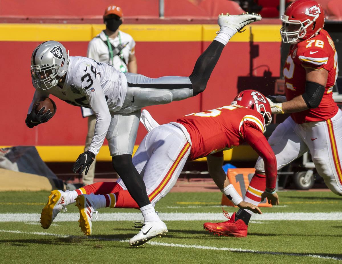 Las Vegas Raiders strong safety Jeff Heath (38) leaps over Kansas City Chiefs quarterback Patri ...