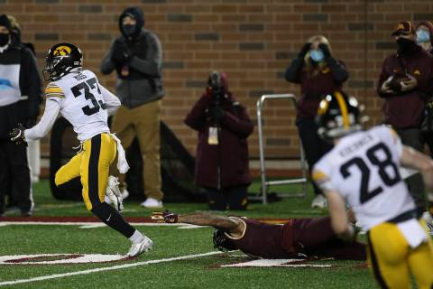 Iowa defensive back Riley Moss (33) outruns Minnesota wide receiver Chris Autman-Bell (7) after ...