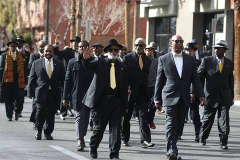 Members of the 100 Black Men of Las Vegas organization participate during the 38th annual Dr. M ...