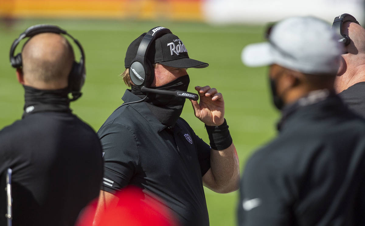 Las Vegas Raiders head coach Jon Gruden coaches from the sideline during the 1st quarter of an ...