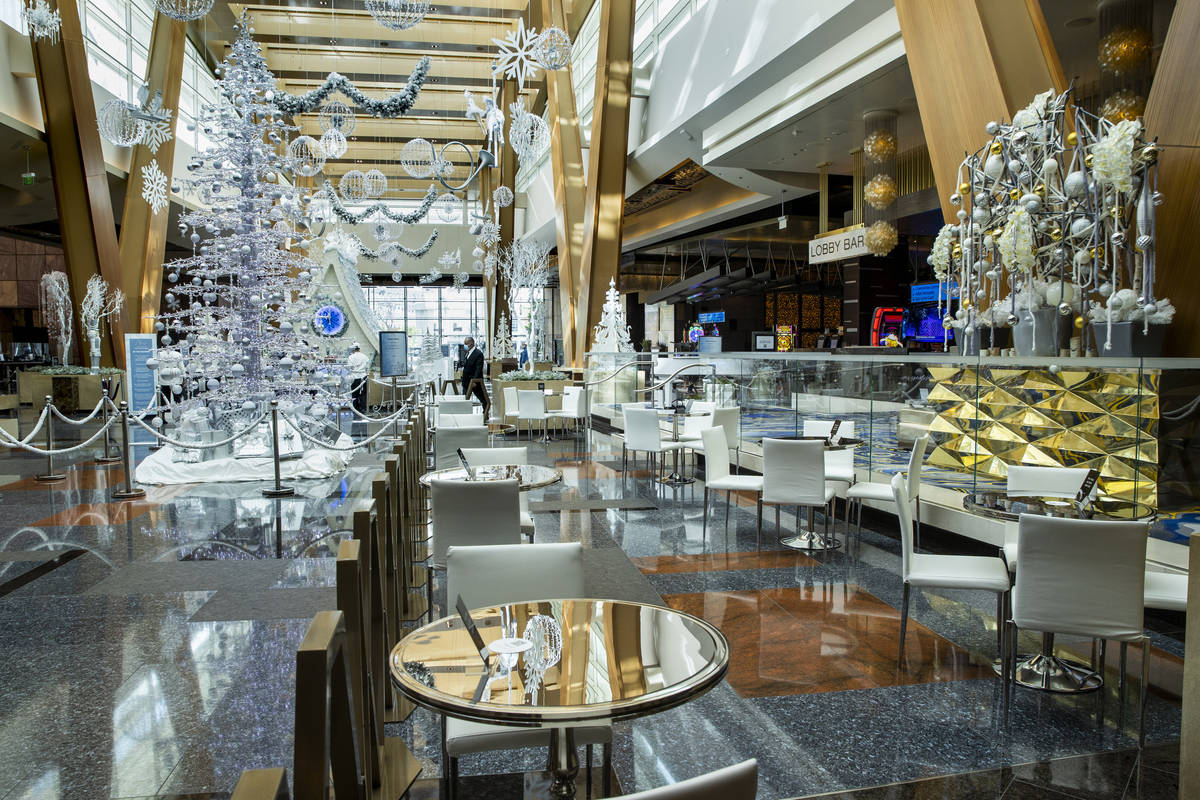 A small dining area is apart of the Aria unveiling of their holiday lobby display, a Sugar Pala ...