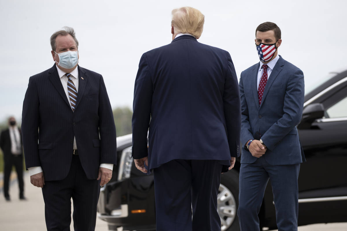 FILE - In this May 21, 2020, file photo, President Donald Trump is greeted by Kurt Heise, left, ...