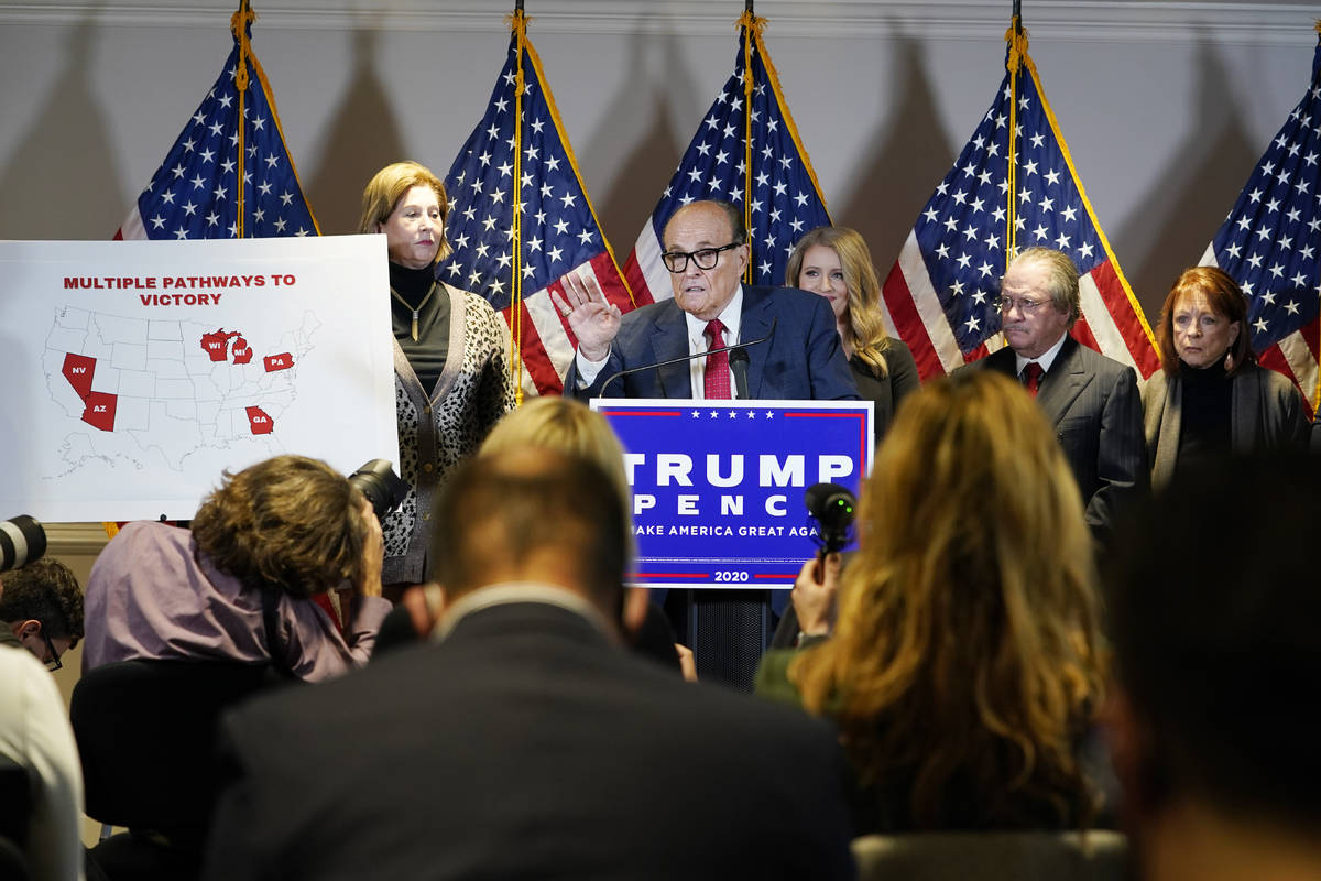 Former Mayor of New York Rudy Giuliani, a lawyer for President Donald Trump, speaks during a ne ...