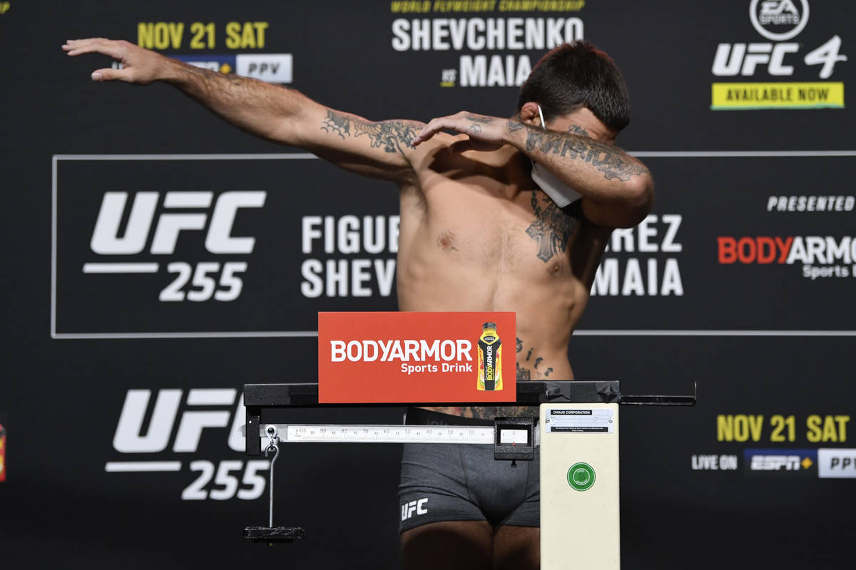 Mike Perry poses on the scale during the UFC 255 weigh-in at UFC APEX on November 20, 2020, in ...