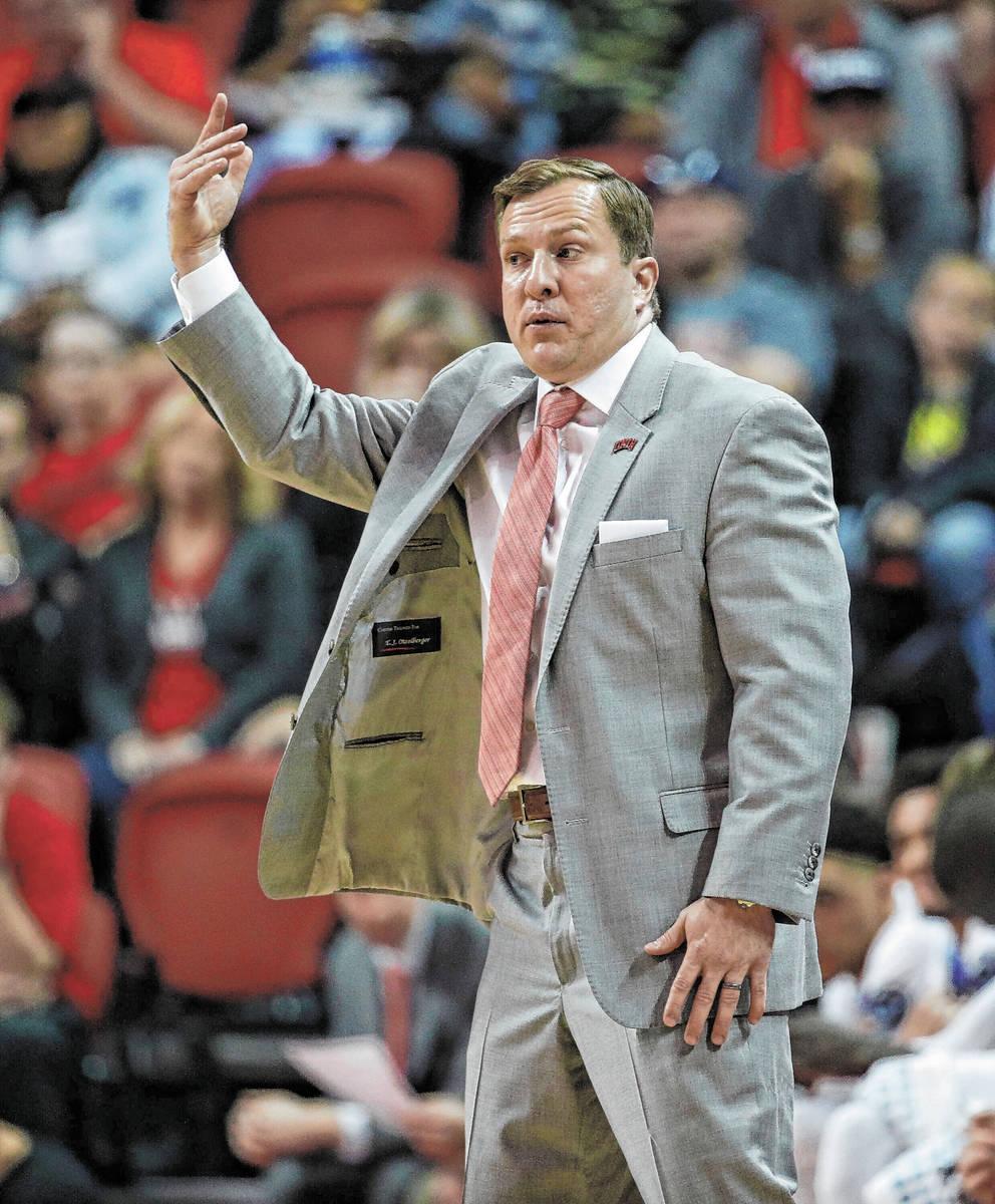 UNLV head coach T. J. Otzelberger coaches against Kansas State in an NCAA college basketball ga ...