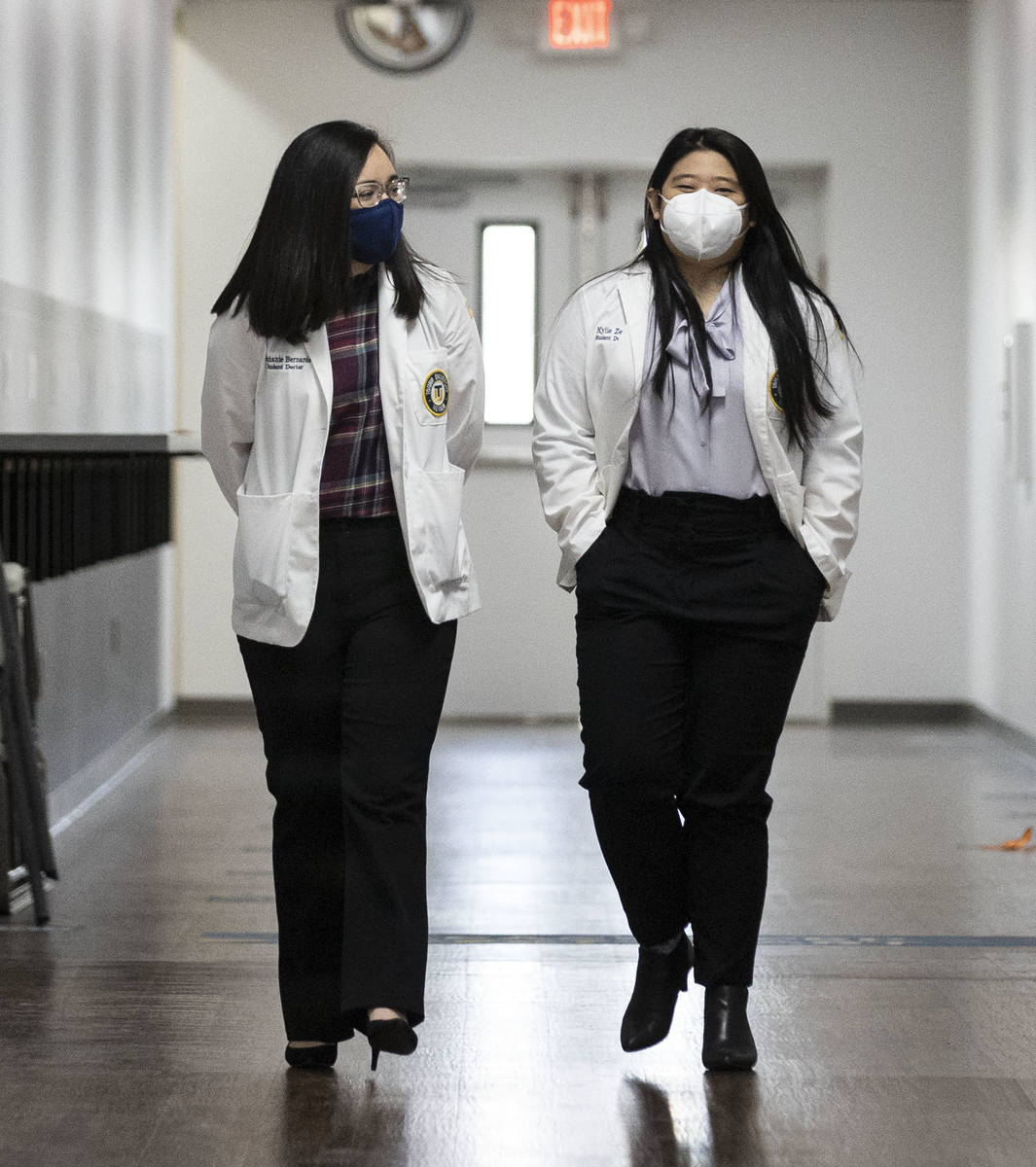 Toro University Nevada students, Stephanie Bernardo, left, and Kylie Zeng walk at their school, ...