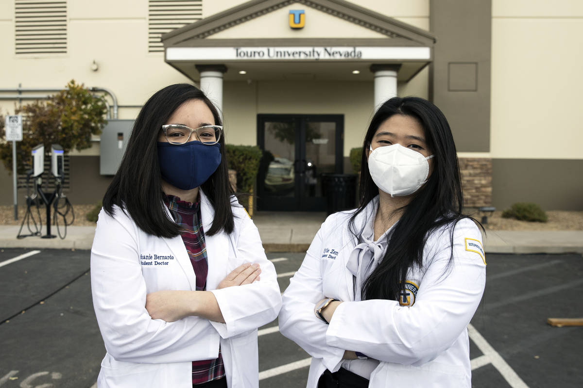 Toro University Nevada students, Stephanie Bernardo, left, and Kylie Zeng pose for a photo, on ...