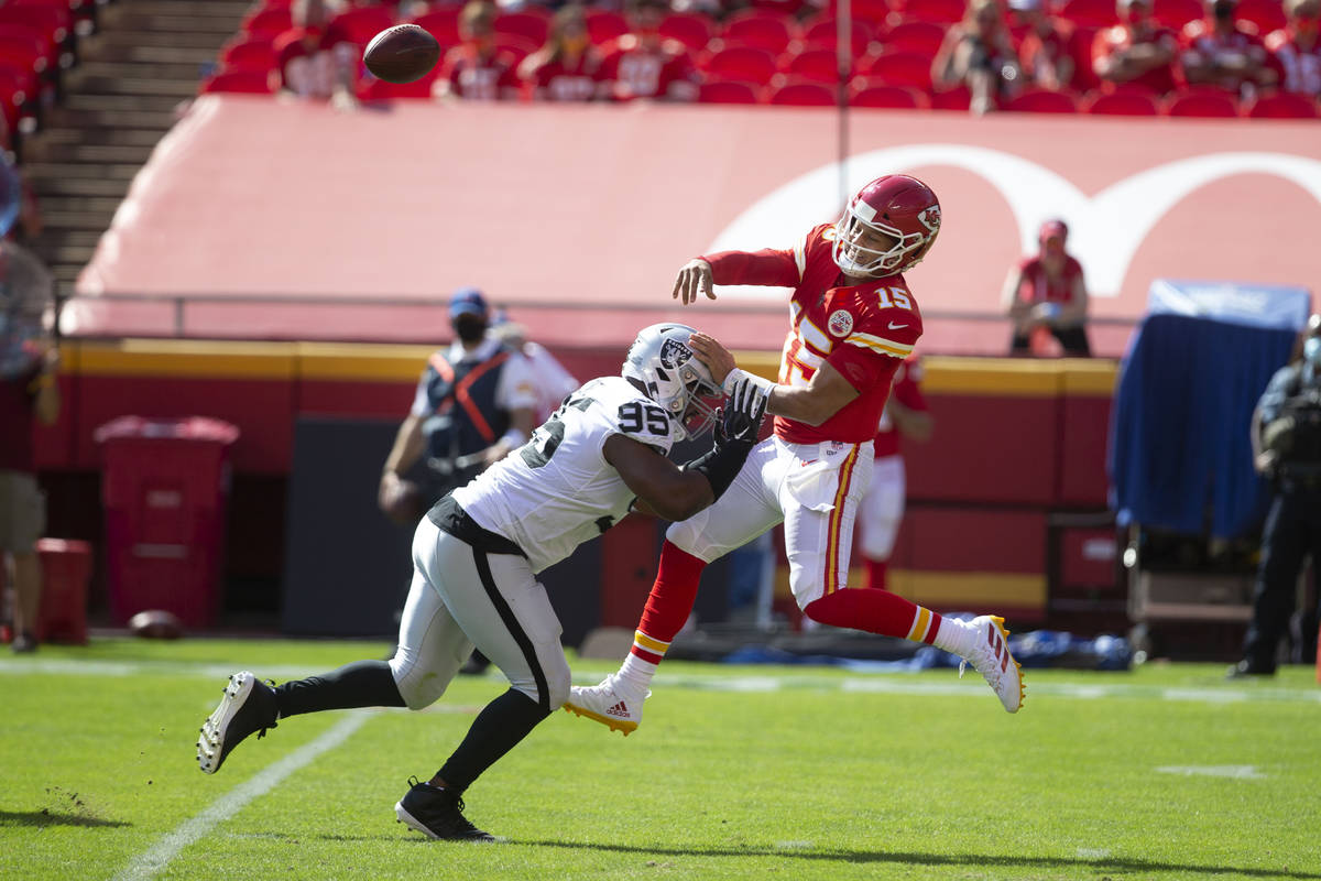 Las Vegas Raiders defensive end Datone Jones (95) pressures Kansas City Chiefs quarterback Patr ...