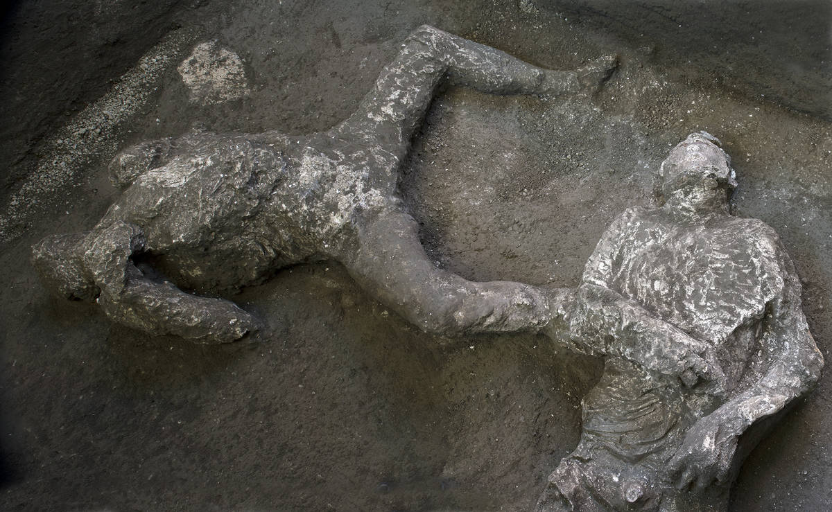 The casts of what are believed to have been a rich man and his male slave fleeing the volcanic ...