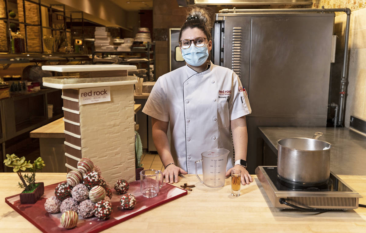 Pastry chef Brittany Simmons prepares to make a hot cocoa bomb cocktail on Monday, Nov. 23, 202 ...
