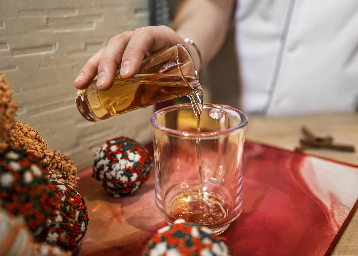 Pastry chef Brittany Simmons pours 2 oz. of Captain Morgan Gingerbread Rum into a coffee mug in ...
