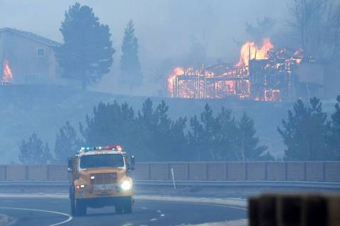 Firefighters battle the Pinehaven Fire in the Caughlin Ranch area of Reno on Tuesday, Nov. 17, ...