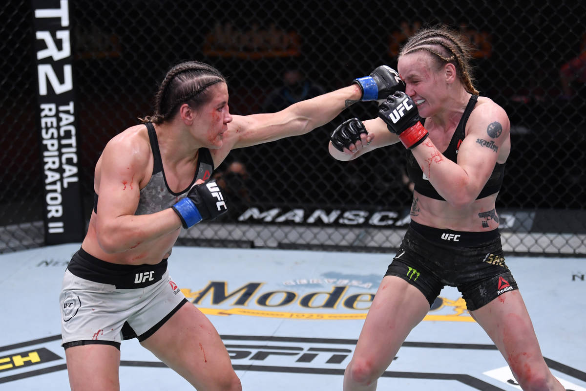 LAS VEGAS, NV - NOVEMBER 21: (L-R) Jennifer Maia of Brazil punches Valentina Shevchenko of Kyr ...