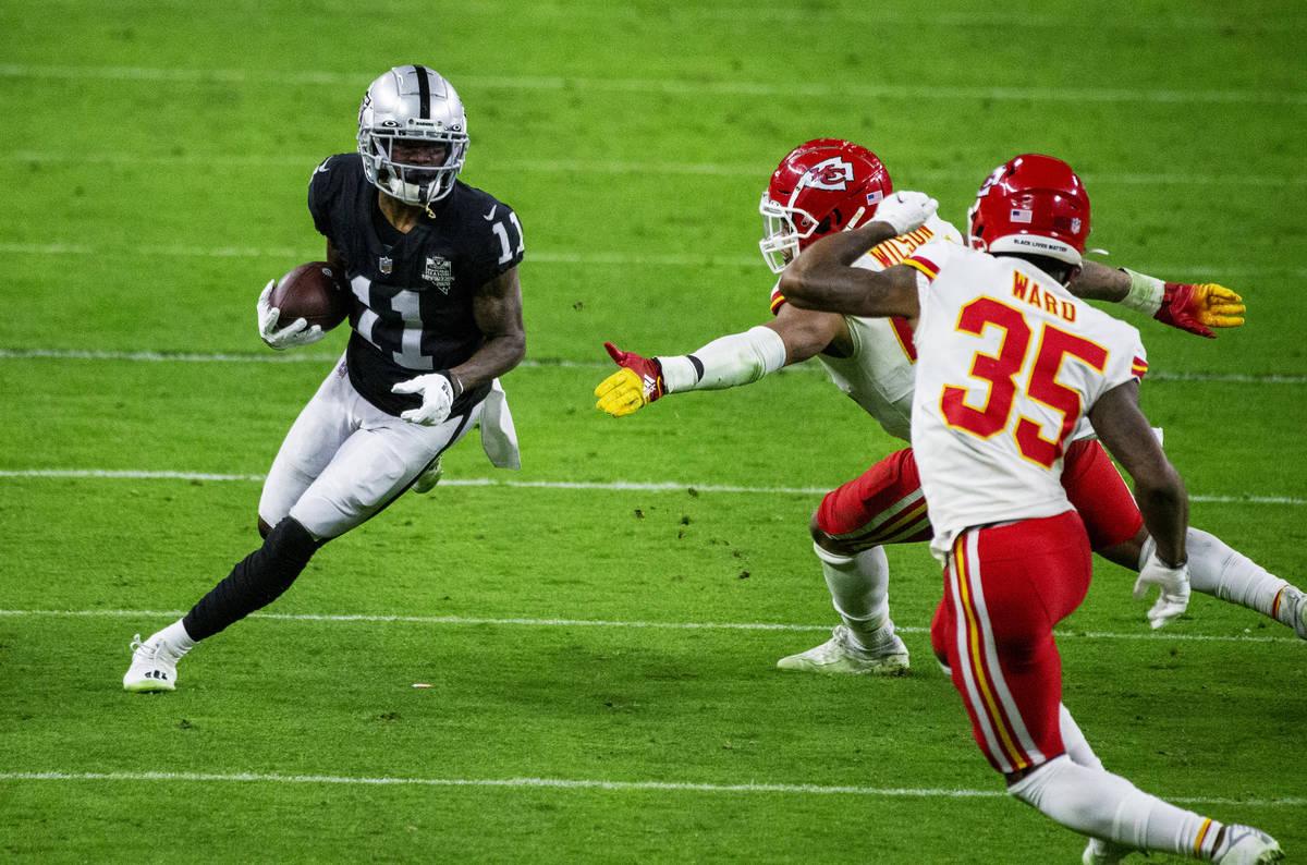 Las Vegas Raiders wide receiver Henry Ruggs III (11) runs with the football as Kansas City Chie ...
