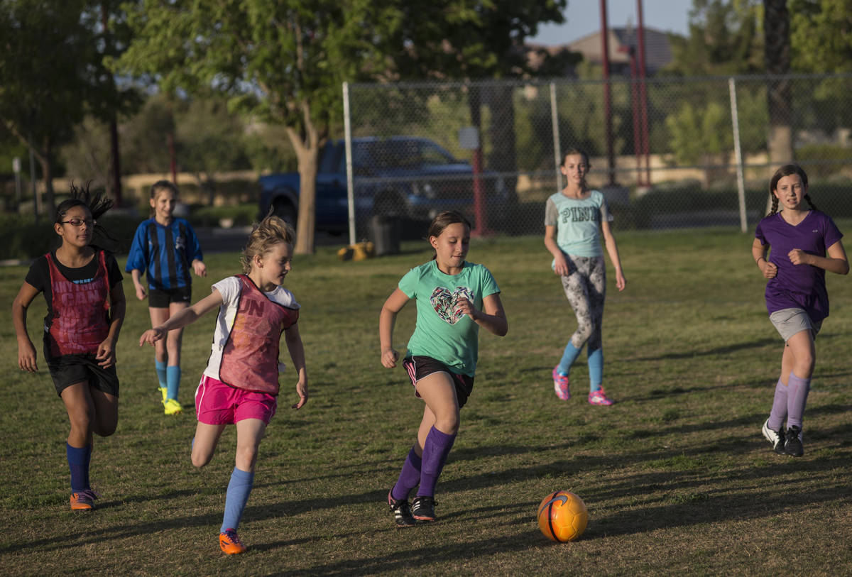 The American Youth Soccer Organization (AYSO) region 1258 kids under 12 team practices at Summe ...