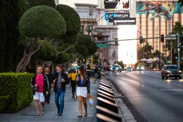 People walk along the Las Vegas Strip Thursday, Nov. 19, 2020. (Chase Stevens/Las Vegas Review- ...