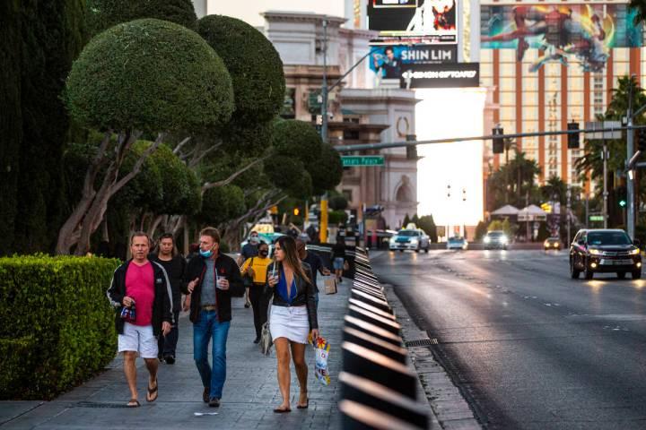 People walk along the Las Vegas Strip Thursday, Nov. 19, 2020. (Chase Stevens/Las Vegas Review- ...