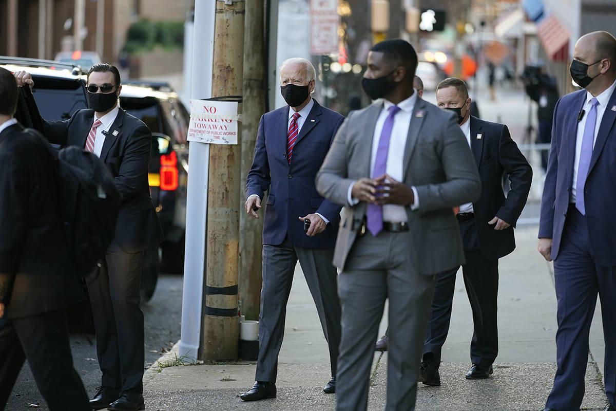 President-elect Joe Biden walks to his motorcade as he leaves The Queen theater Monday, Nov. 23 ...