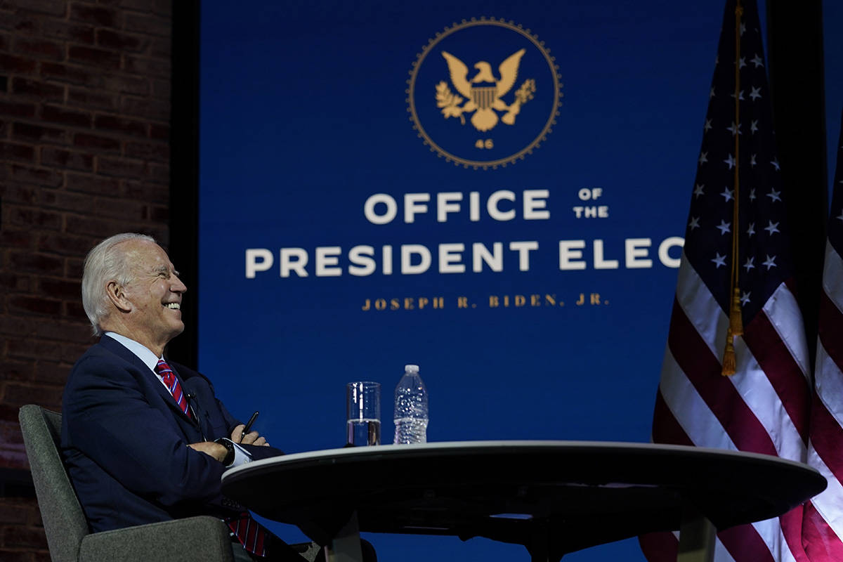 President-elect Joe Biden smiles as he meets virtually with the United States Conference of May ...