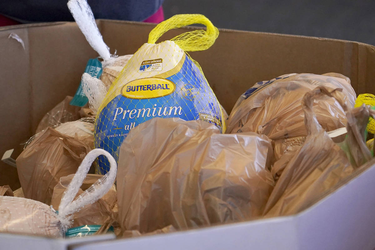 Forty five donated frozen turkeys await collection at this north Jackson, Miss., Kroger grocery ...