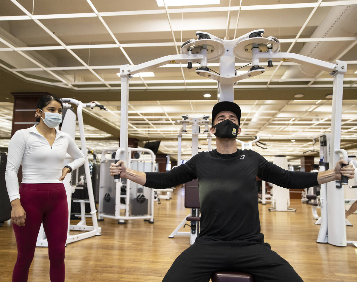 Travis Noone, right, works out with Alandra Ramirez at Life Time Athletic on Monday, Nov. 23, 2 ...