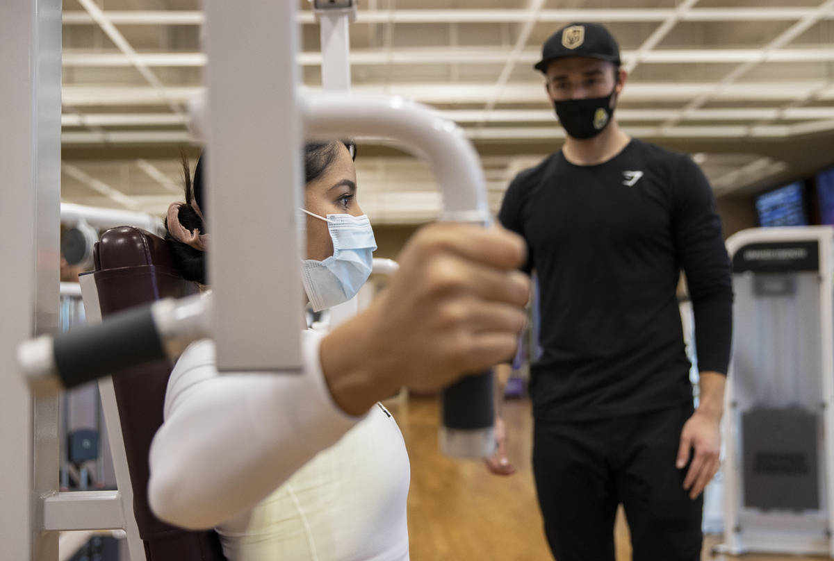 Alandra Ramirez, left, works out with Travis Noone at Life Time Athletic on Monday, Nov. 23, 20 ...