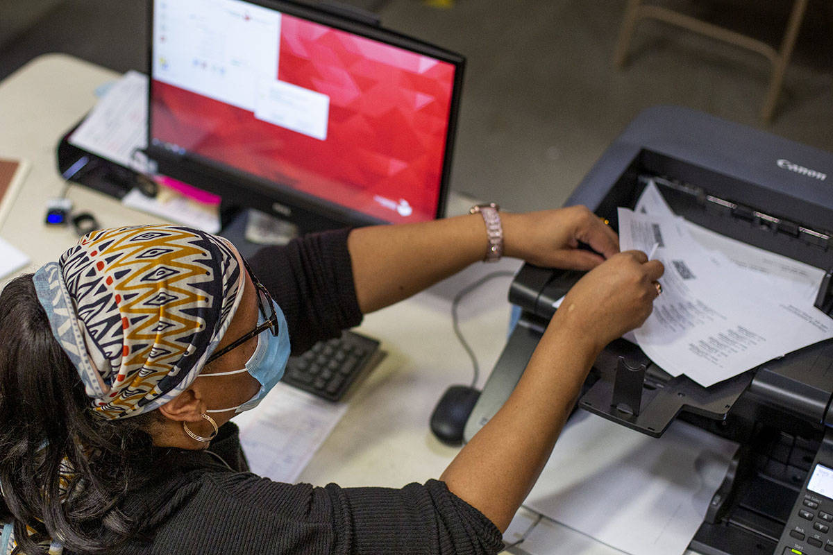 Mail-in ballots are counted at Clark County Election Center on Wednesday, Nov. 4, 2020, in Las ...