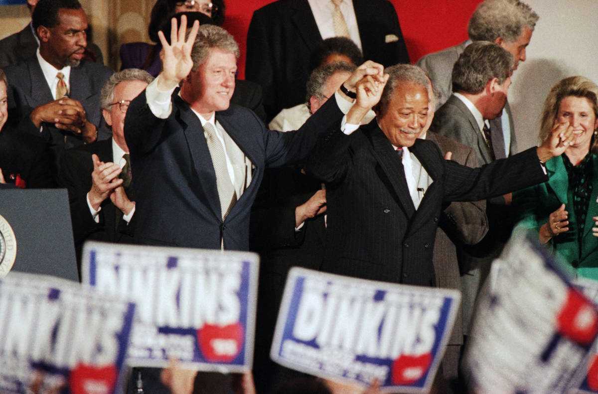 FILE - In this Thursday, Oct. 28, 1993, file photo, President Bill Clinton holds up four finger ...