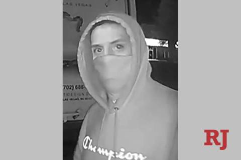 A surveillance photo of a man wanted in connection with a series of burglaries in the area of S ...