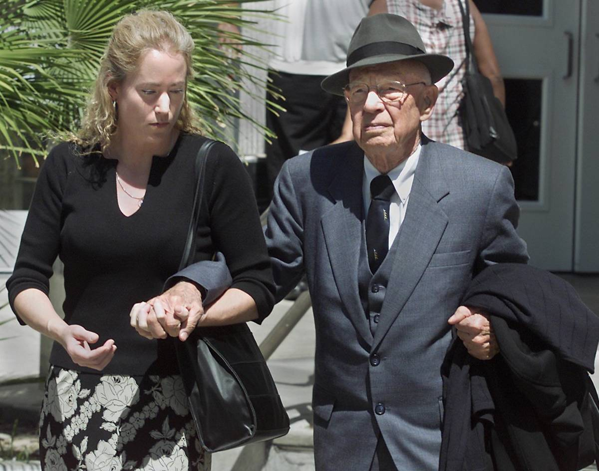 Dr Quincy Fortier is supported by his daughter, Nanette, after leaving district court following ...