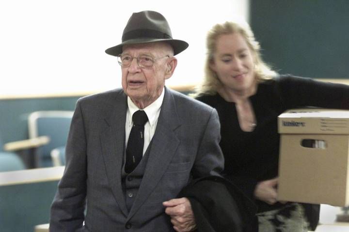 Dr. Quincy Fortier leaves the courtroom with his daughter, Nanette, after a settlement was reac ...