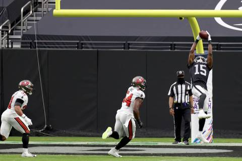 Las Vegas Raiders wide receiver Nelson Agholor (15) catches a touchdown pass in front of Tampa ...