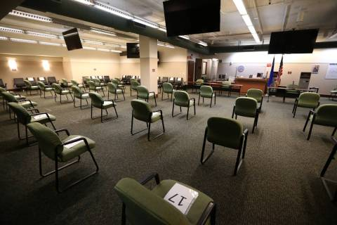 A social distancing seating arrangement at the Regional Justice Center jury services room is se ...