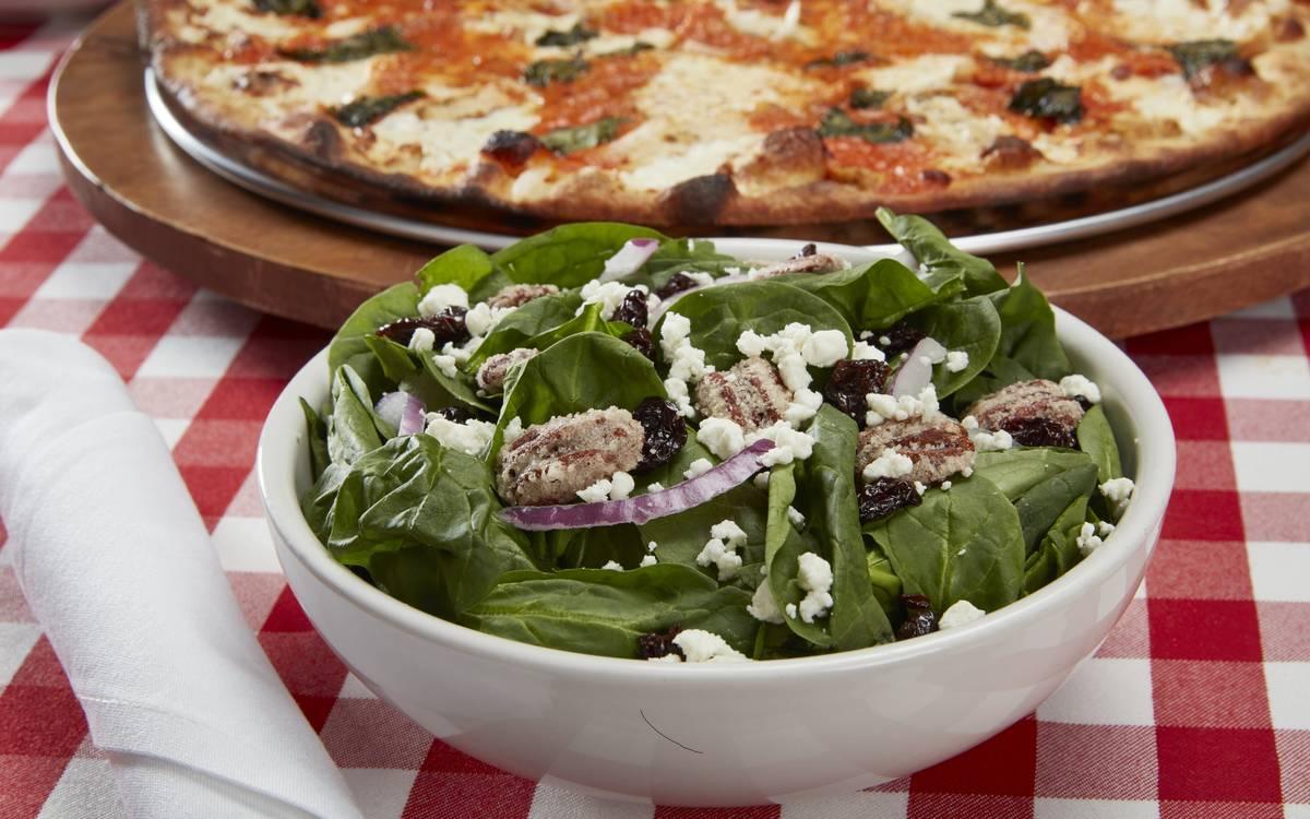 Chicken al la vodka pizza and spinach-pecan salad at Grimaldi's Coal Brick-Oven Pizzeria. (Grim ...