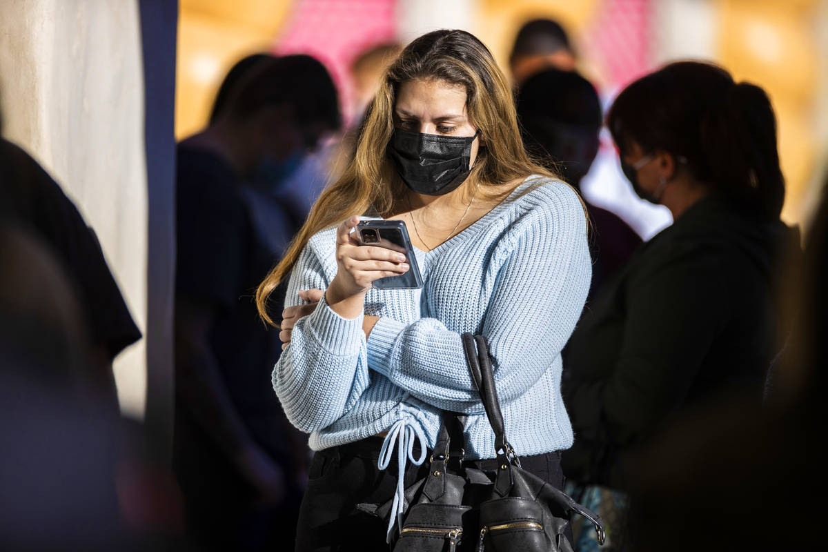 Shoppers wait in line outside Victoria's Secret during Black Friday at Town Square on Friday, N ...