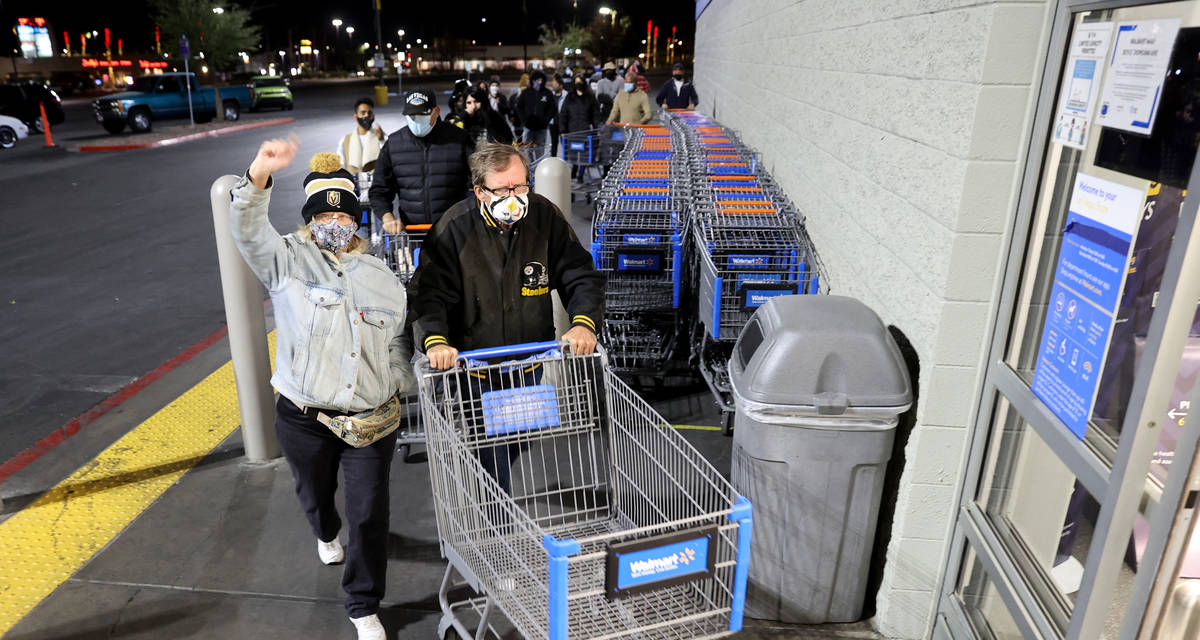 Shoppers file in for the 5 a.m. opening at Walmart on East Tropicana Avenue at McLeod Drive in ...